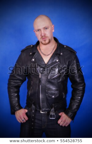 man posing spread legs and hands on waist in studio Stock photo © feedough