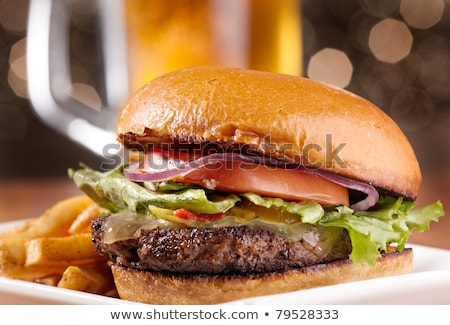 Hamburger with beer and fries in the background ready to be eate Stock photo © phila54