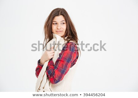 Attractive young woman in plaid shirt and waistcoat Stock photo © deandrobot