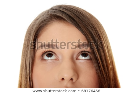 cropped image of a girl with her eyes looking away stock photo © deandrobot