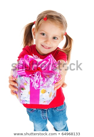 Cute five year old girl wrapping a Christmas gift Stock photo © ozgur