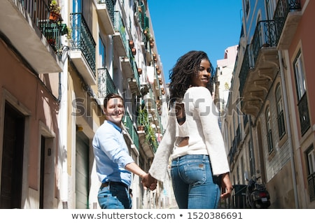 low angle view of female tourist walking down the street stock photo © stevanovicigor