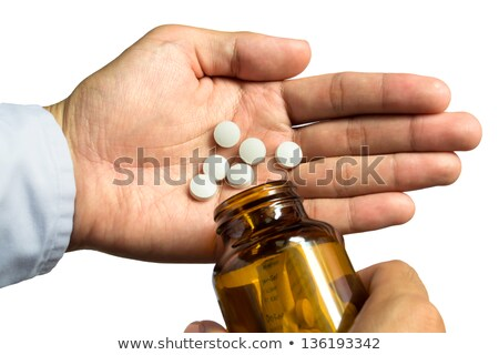 Nurse pouring pills in hand isolated Stock photo © deandrobot