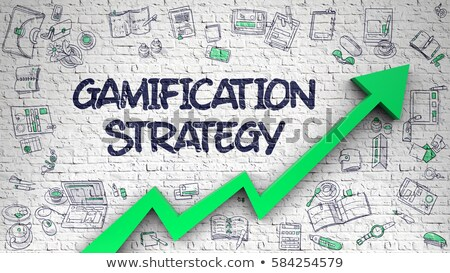 gamification on white brick wall stock photo © tashatuvango