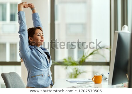 Graphic designer stretching her arms Stock photo © wavebreak_media