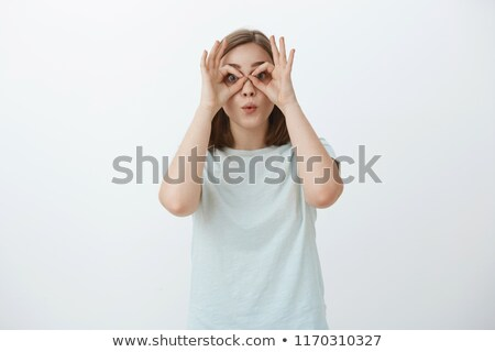 young girl with hands folded around lips Stock photo © IS2
