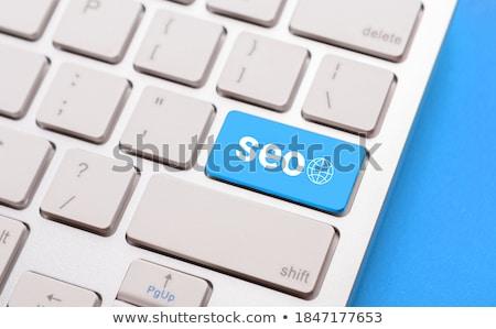 Teclado azul botón optimización delgado aluminio Foto stock © tashatuvango