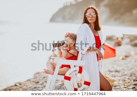 Cute kobieta ratownik patrząc lornetki plaży Zdjęcia stock © jossdiim