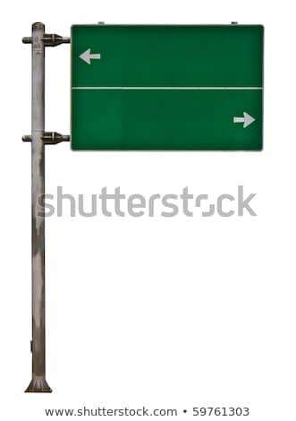 ストックフォト: ��路交通標識を保持している女性