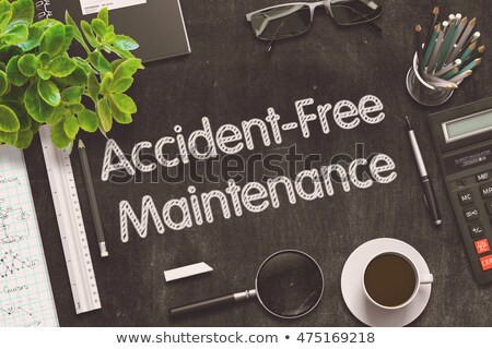 Accident-Free Maintenance on Black Chalkboard. 3D Rendering. Stock photo © tashatuvango