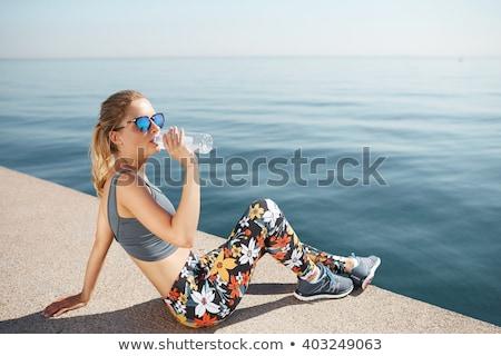 Nő ivóvíz pihen jogging park fiatal Stock fotó © vlad_star