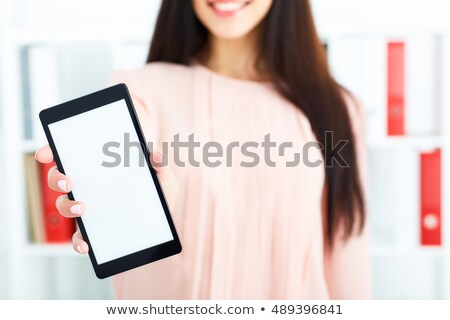 Smiling woman showing a cell phone. Technology presentation situation. Vector isolated outline illus Stock photo © vasilixa
