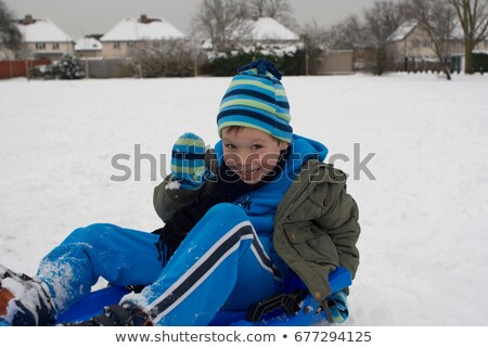 Młody chłopak sanki śniegu zimą uśmiechnięty Zdjęcia stock © IS2