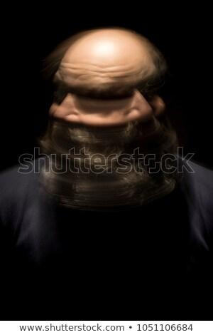 motion blur portrait of a bearded bald head man Stock photo © magann