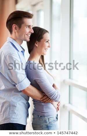 Young woman gazing at man through a window Stock photo © IS2
