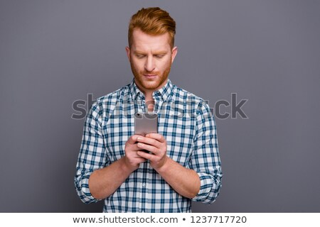 portrait of confident young man with red checkers shirt Stock photo © feedough