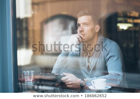 Pensive homme séance cafétéria vue de côté Photo stock © ichiosea