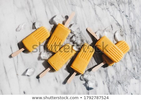 cubes of ice on a gray marble table concept of a cold summer drink flat lay stock photo © artjazz