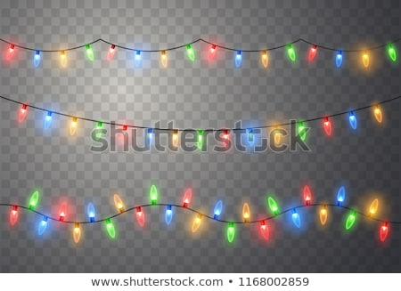 christmas golden decorations set with colorful lights stock photo © voysla