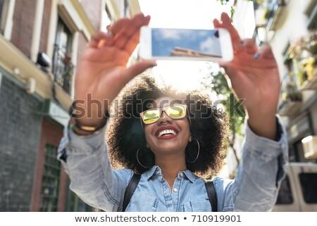 молодые · черную · женщину · Постоянный · городской · улице · зданий · девушки - Сток-фото © Stasia04