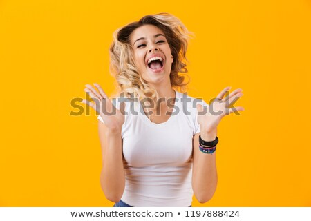 Photo of happy blond woman in basic clothing screaming and touch Stock photo © deandrobot