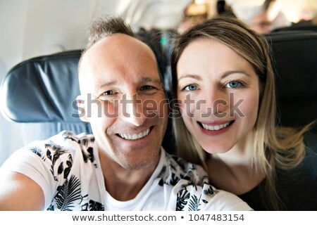 Pareja sonrisa felizmente avión mujer cielo Foto stock © Lopolo