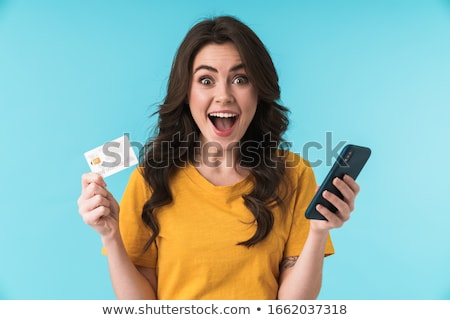 Geschokt jonge mooie vrouw geïsoleerd Blauw muur Stockfoto © deandrobot