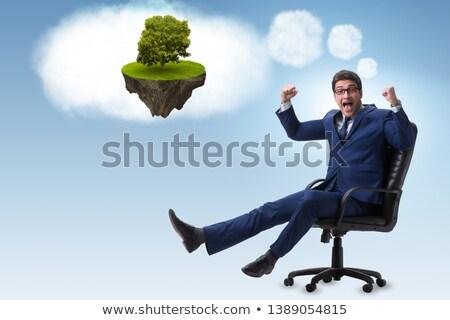 Fiatal üzletember álmodik jobb dolgok felhők Stock fotó © Elnur