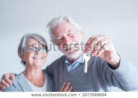 Mature lady with a house key. Stock photo © Kurhan