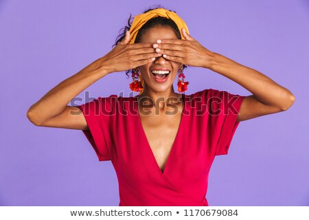 image of beautiful amusing woman 20s in hair band and earrings s stock photo © deandrobot