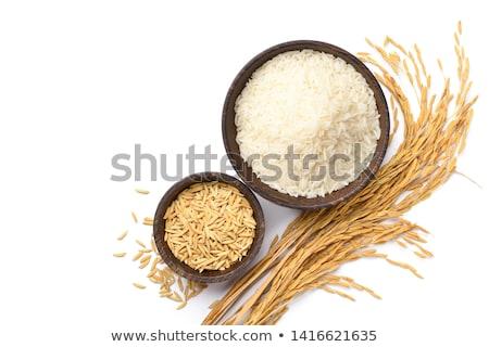 Pile of brown rice grain on white wooden background Stock photo © Melnyk