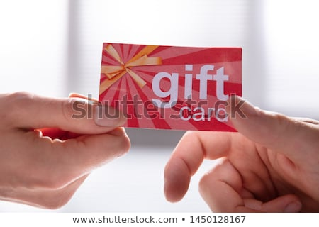Female Hand Giving Gift Card To Her Partner Stock photo © AndreyPopov