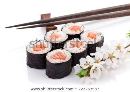 Foto d'archivio: Sushi Maki Set And Sakura Branch Isolated On White Background