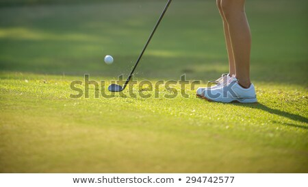 Woman pitching at golf course. Stock photo © lichtmeister