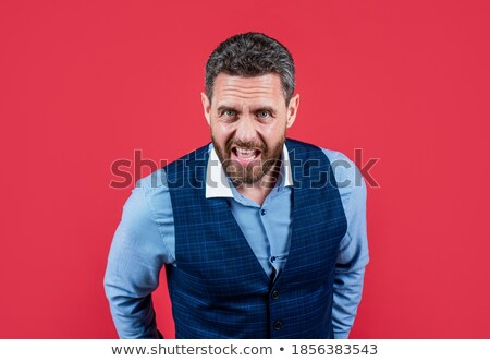 Desperate business executive screaming loudly. Stock photo © lichtmeister
