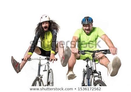 Two eccentric guys riding a bikes - team work Stock photo © majdansky
