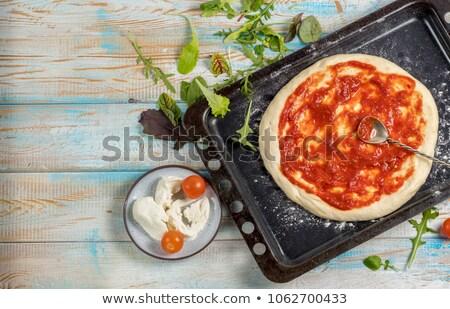 Raw Pepperoni, Mozzarella Cheese And Vegetables On Pizza Base Stock photo © AndreyPopov