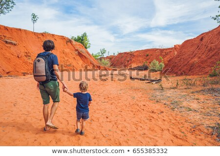 young man in red canyon near mui ne southern vietnam stock photo © galitskaya