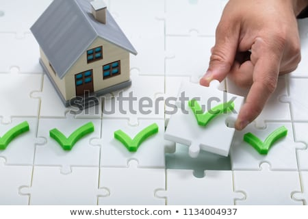 Person's Hand Solving Check Mark Puzzle Stock photo © AndreyPopov