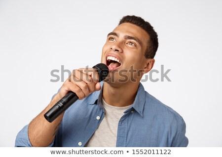 Zorgeloos jonge man christmas partij zingen Stockfoto © benzoix