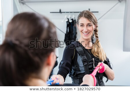 Skinny and plump woman having ems training together Stock photo © Kzenon