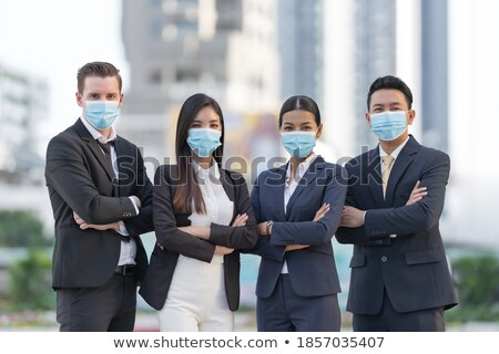Group of four young women wearing surgical masks. Corona virus 2019-nCov motivation poster design wi Stock photo © BlueLela
