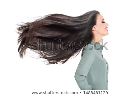 Portrait of amazing beautiful young woman with long straight hair, stands sideways, shows shoulder,  Stock photo © vkstudio