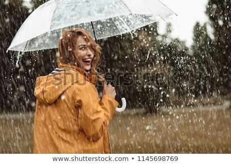 happy smiles in the rain with umbrella Stock photo © godfer