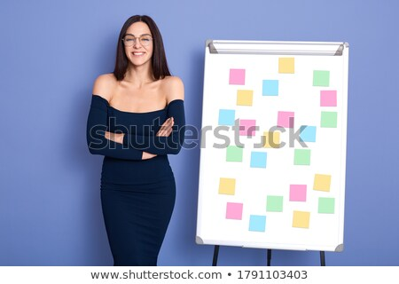 happy businesswoman pointing at empty flip chart stock photo © candyboxphoto