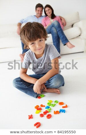 Mother watching son playing with toys Stock photo © photography33