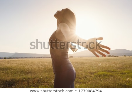 asian young woman haapy raise hands and spread arms Stock photo © ampyang