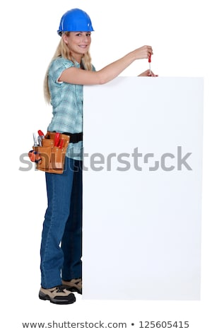 Tradeswoman holding a screwdriver over a blank sign Stock photo © photography33