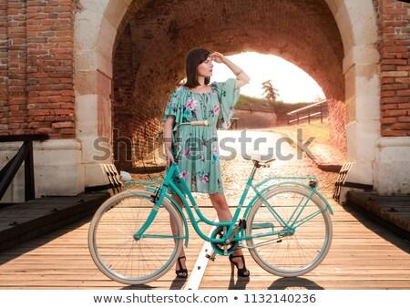 brunette in teal dress Stock photo © yurok