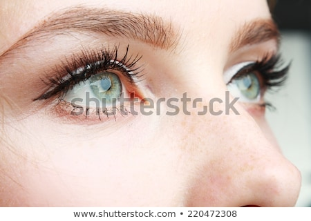 Primer plano hermosa ojo amarillo verde maquillaje Foto stock © vlad_star